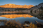 Morning Alpenglow on mountain reflected in Booth Lake; Vogelsang region; Yosemite National Park; California
