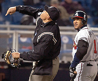 Atlanta Braves' Gary Sheffield (1) is thrown out for arguing a strike called by umpire Kerwin Danley, left, in the fifth inning Tuesday, April 8, 2003, against the  Philadelphia Phillies in Philadelphia.  Moments later, Manager Bobby Cox was also tossed as he supported Sheffield's cause. (AP Photo/Brad C. Bower)