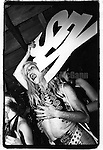 "June 15, 1988:   Drag queen Lahoma Van Zandt t holding a sign which says ""sex""  at the Celebrity Club at Tunnel nightclub in New York City, New York."