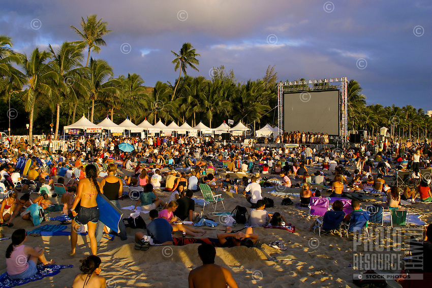 Sunset on the Beach attracts visitors and locals alike to waikiki beach to enjoy hula dancing,local food,a movie and of course a beautiful hawaiian sunset. Oahu.