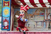 Covent Garden, London, UK. 11 May 2014. Punch & Judy theatres in the churchyard of St. Paul's. The Covent Garden May Fayre and Puppet Festival takes place at St Paul's Church.