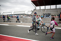 Miguel 'Superman' Angel Lopez (COL/Astana) followed by some fans at the race start at the Navarra moto race circuit<br /> <br /> Stage 12: Circuito de Navarra to Bilbao (171km)<br /> La Vuelta 2019<br /> <br /> ©kramon