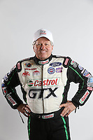 Feb. 22, 2013; Chandler, AZ, USA; NHRA funny car driver John Force poses for some pictures during qualifying for the Arizona Nationals at Firebird International Raceway. Mandatory Credit: Mark J. Rebilas-