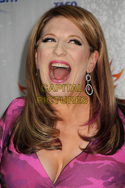 LISA LAMPANELLI.Comedy Central Roast of Larry The Cable Guy at the Warner Brothers Studios, Burbank, California, USA..March 1st, 2009.headshot portrait pink dangling earrings lipstick mouth open funny face cleavage .CAP/ADM/BP.©Byron Purvis/AdMedia/Capital Pictures.