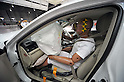 "July 21st, 2011, Susonosi, Japan - A passenger seat airbag is fully inflated in a badly damaged Toyota Crown after a head-on collision with a Toyota VITZ at the speed of 55km/h (about 34 miles/h) in a demonstration at Toyotas Higashi-Fuji Technical Center on the foot of Mt. Fuji, some 92km (about 57 miles) southwest of Tokyo, on Thursday, July 21, 2011. Toyota showed to reporters technologies aimed at increasing safety for pedestrians and elderly drivers, as part of its initiatives to eliminate traffic casualties. The technologies include a Pre-Collision System with collision-avoidance assist, glare-preventing adaptive driving beams and a pop-up hood for lessening pedestrian injury. In the PCS, Toyota uses cameras and a super sensitive radar called ""millimeter-wave,"" both installed in the front of the vehicle, to detect possible crashes such as a pedestrian crossing the road. Then the vehicle calculates how braking and steering must be applied to avoid a crash. (Photo by Natsuki Sakai/AFLO) [3615] -mis-"