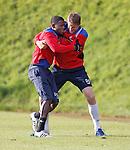 Maurice Edu and Dorin Goian grappling