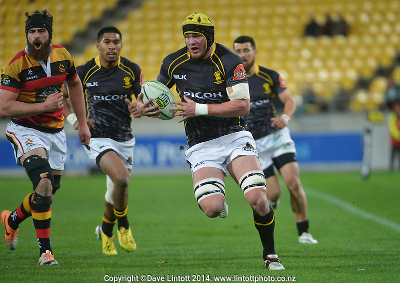 Adam Hill on attack during the ITM Cup rugby union match between Wellington Lions and Waikato at Westpac Stadium, Wellington, New Zealand on Saturday, 16 August 2014. Photo: Dave Lintott / lintottphoto.co.nz