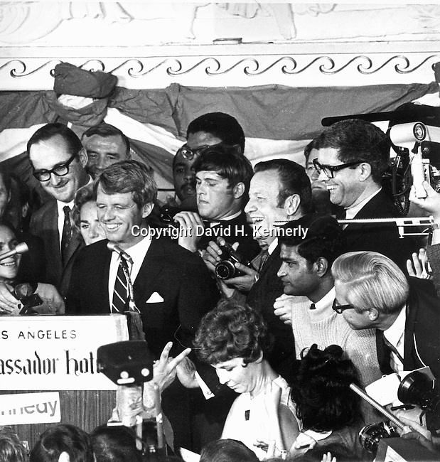 Ron Bennett Photographer behind Robert Kennedy at speach Ambassador Hotel Los Angeles CA, Sirhan Sirhan taken away by police after assassination of Robert F. Kennedy, Sirhan Sirhan held by RFK staff and Rosey Grier, Robert F. Kennedy, RFK, Bobby, Bobby Kennedy, assassination of RFK, assassination, assassination of Robert F. Kennedy, Ethel Kennedy, June 5 1968, Sirhan Sirhan,  Ambassador Hotel Los Angeles California, Rosey Grier, George Plimpton, Rafer Johnson, photojournalism, Photojournalist, collecting editing, presenting news photographs, Photojournalism provides visual support for stories, mainly in the print media,  Commercial photography's main focus is to sell a product or service. Fine Art photography are photographs that are created to fulfill the creative vision of the photographer, Photojournalism provides visual support for stories, mainly in the print media,  Commercial photography's main focus is to sell a product or service. Fine Art photography are photographs that are created to fulfill the creative vision of the photographer,  RFK Photo's by Ron Bennett, Robert F. Kennedy photographs by Ron Bennett, Robert F.  Bobby Kennedy assassination photographs by Ron Bennett, Sirhan Sirhan photographs by Ron Bennett, RFK Photographs by Ronald T. Bennett,