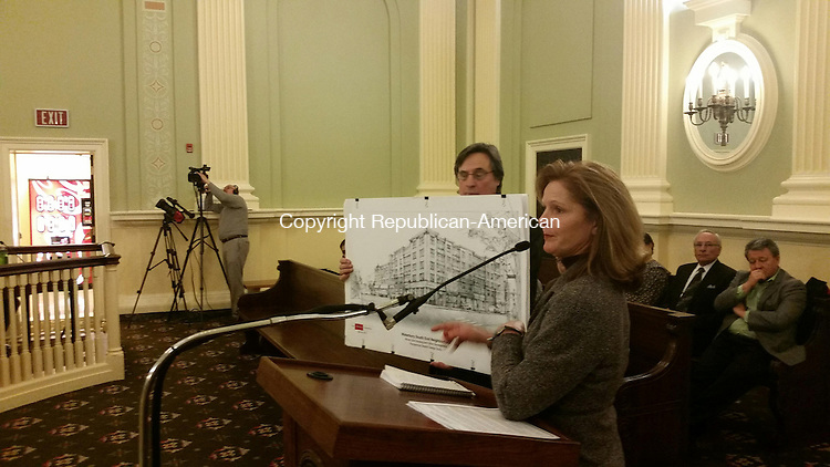WATERBURY -- Nancy MacMillan, executive director of Loyola Development Corp., and the group's attorney, James Stedronsky, display a rendering of a planned 44-unit affordable housing development at the Board of Aldermen meeting Monday.