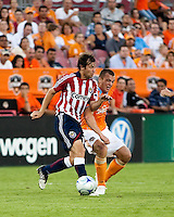 Chivas USA defender Carey Talley (12) and Houston Dynamo forward Cam Weaver (15) fight for control of the ball.  Houston Dynamo defeated CD Chivas USA 1-0 at Robertson Stadium in Houston, TX on June 10, 2009.