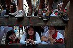 People attend the first bull run of the San Fermin Festival, on July 7, 2013, in Pamplona, northern Spain. The festival is a symbol of Spanish culture that attracts thousands of tourists to watch the bull runs despite heavy condemnation from animal rights groups. AFP PHOTO/ PEDRO ARMESTRE