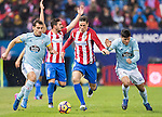 Fernando Torres (c) of Atletico de Madrid fights for the ball with Jonathan Castro Otto Jonny of RC Celta de Vigo during their La Liga match between Atletico de Madrid and RC Celta de Vigo at the Vicente Calderón Stadium on 12 February 2017 in Madrid, Spain. Photo by Diego Gonzalez Souto / Power Sport Images