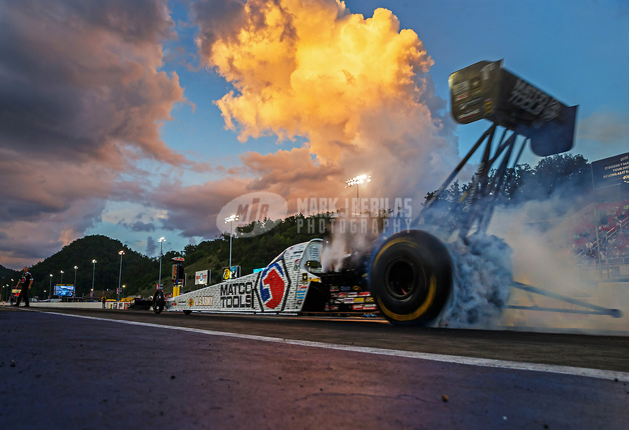 Jun 16, 2017; Bristol, TN, USA; NHRA top fuel driver Antron Brown does a burnout during qualifying for the Thunder Valley Nationals at Bristol Dragway. Mandatory Credit: Mark J. Rebilas-USA TODAY Sports