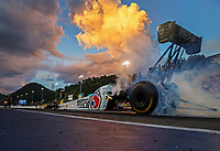 Jun 16, 2017; Bristol, TN, USA; NHRA top fuel driver Antron Brown does a burnout during qualifying for the Thunder Valley Nationals at Bristol Dragway. Mandatory Credit: Mark J. Rebilas-USA TODAY Sports