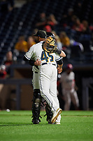 Akron RubberDucks pitcher Dalbert Siri (45) and catcher Logan Ice (9) celebrate closing out an Eastern League game against the Reading Fightin Phils on June 4, 2019 at Canal Park in Akron, Ohio.  Akron defeated Reading 8-5.  (Mike Janes/Four Seam Images)