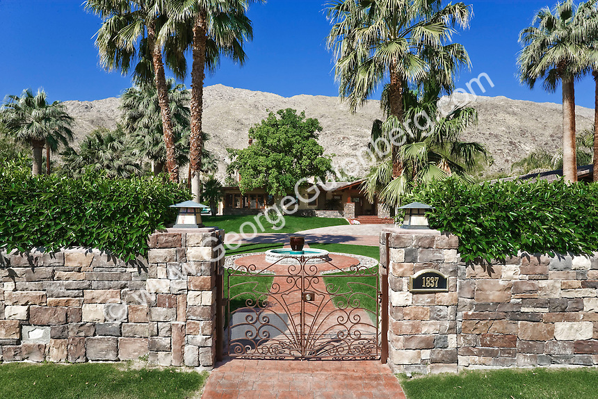 Wrought iron gates in stone wall