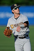 Center fielder Dustin Fowler (5) of the Charleston RiverDogs warms up before a game against the Greenville Drive on Sunday, May 24, 2015, at Fluor Field at the West End in Greenville, South Carolina. Charleston won 3-2. (Tom Priddy/Four Seam Images)