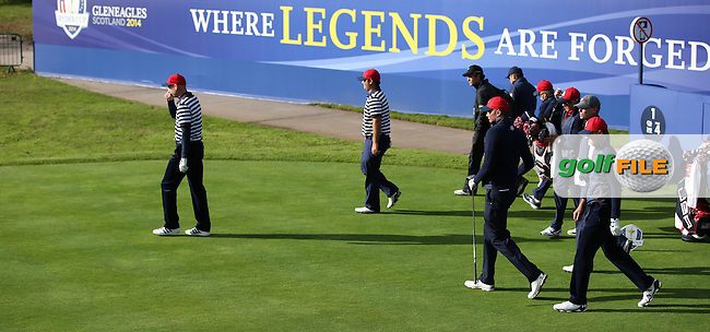 Jim Furyk (USA) Matt Kuchar (USA) and Patrick Reed (USA) head off from the first during the 2014 Ryder Cup from Gleneagles, Perthshire, Scotland. Picture:  David Lloyd / www.golffile.ie