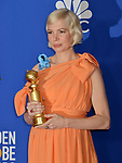 Michelle Williams 120 poses in the press room with awards at the 77th Annual Golden Globe Awards at The Beverly Hilton Hotel on January 05, 2020 in Beverly Hills, California.