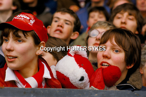 Female football fans with teddy bear mascot. Liverpool the Kop 1980s.<br /> <br /> Sisters Gill and Jan Blair and their mascot teddy bear called &quot;Liverpool&quot;. He never missed a game.; Gill still doesn't.
