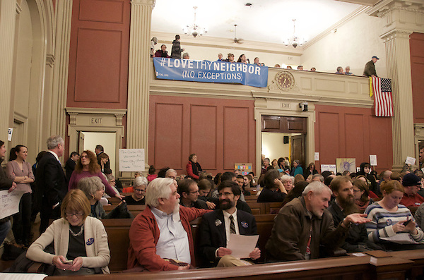 Supporters of a Sanctuary City Ordinance rally at Newton City Hall before a City Council vote in Newton MA 2.8.17
