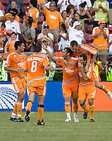 Houston Dynamo players Brian Ching (25), Richard Mulrroney (8), Brad Davis (11) Nate Jaqua (27) and Brian Mullan (9) celebrate a goal.  Houston Dynamo defeated Chicago Fire 2-1 at Robertson Stadium in Houston, TX on August 31, 2008.