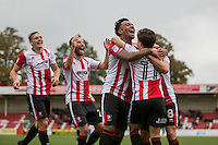 Jack Munns of Cheltenham (11) is mobbed after scoring his side's second goal during the Sky Bet League 2 match between Cheltenham Town and Crawley Town at the LCI Rail Stadium, Cheltenham, England on 15 October 2016. Photo by Mark  Hawkins.