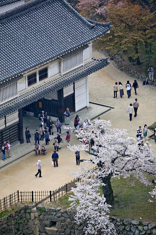 Visitors at the Hishi No Mon gate at Himeji Castle
