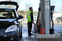 Date 15/03/2019 - SPECIAL TO GO WITH OWEN BOWCOTT STORY - Border Brexit -  A petrol station attendent fills home heating fuel drums for an County Donegal customer, in west Tyrone border town of Strabane. Currently Kerosene is cheaper in Northern Ireland, where locals from County Donegall travel across to buy. Photo/Paul McErlane