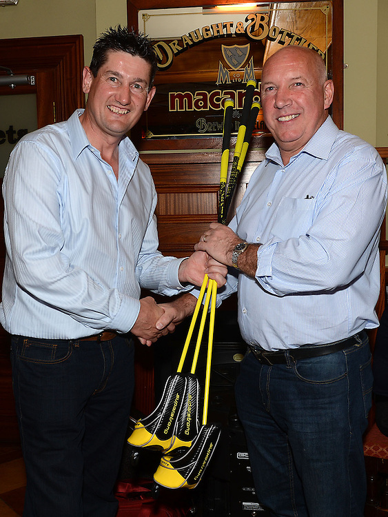 Eugene Holcroft presents Winner Alan Guildea with his prize at Seapoint Golf Captains prizegiving in Tommy Hannratty's Bar & Lounge. Photo:Colin Bell/pressphotos.ie