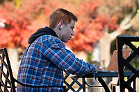 With only a week of classes remaining this semester, Cameron R. O'Daniel, a senior communication/public relations major from Tupelo, studies outside Colvard Student Union. Sunshine this week is accompanying colder temperatures on campus.<br />  (photo by Megan Bean / &copy; Mississippi State University)