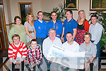 CHEQUE IT OUT: On Friday night at Kerin's O'Rahilly's GAA clubhouse Damian Moran (seated 2nd right) presented a cheque for €5,665 to Henry Burrows (chairman of MS Tralee) from monies raised at a charity Sky Dive and Dog Show recently. Seated l-r: Hannah O'Flaherty, Gavin and Henry Burrows with Damian and Audrey Moran. Back l-r: Mary O'Keeffe (MS Tralee), Keira Boyd, Bryan Scannell, Bryan Marau, Robert Pearce, Karina O'Mahony and Danny McElligott.