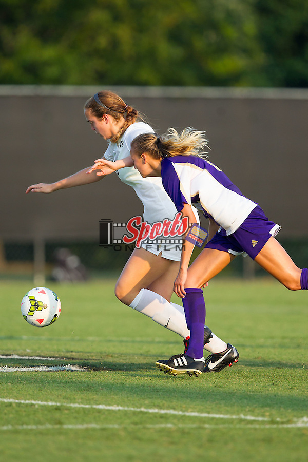 Claudia Day (18) of the Wake Forest Demon Deacons keeps the ball away from Allie Bunner (2) of the James Madison Dukes during second half action at Spry Soccer Stadium on August 29, 2014 in Winston-Salem, North Carolina.  The Dukes defeated the Demon Deacons 2-1.   (Brian Westerholt/Sports On Film)