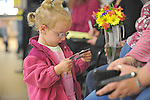 Shelbie Stevens, 3, holds her two aunts' Iowa state IDs while they wait for their marriage license first thing in the morning at the Scott County Recorder's Office the first day same sex weddings are legal across Iowa in Davenport, Iowa on April 27, 2009.