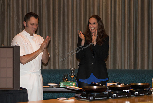 RENO Magazine editor Laura Longero Holman, right, introduces Chef Michael Mahoney during a cooking demonstration inside Charlie Palmer Lounge in the Grand Sierra Resort on Thursday night, October 12, 2017.