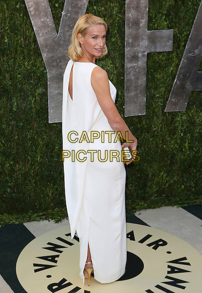 Kelly Lynch.2013 Vanity Fair Oscar Party following the 85th Academy Awards held at the Sunset Tower Hotel, West Hollywood, California, USA..February 24th, 2013.oscars full length white sleeveless dress looking over shoulder cape .CAP/ADM/SLP/DOW.©Dowling/StarlitePics/AdMedia/Capital Pictures