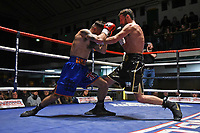 Chris Bourke (black shorts) defeats Jake Pollard during a Boxing Show at York Hall on 2nd February 2019