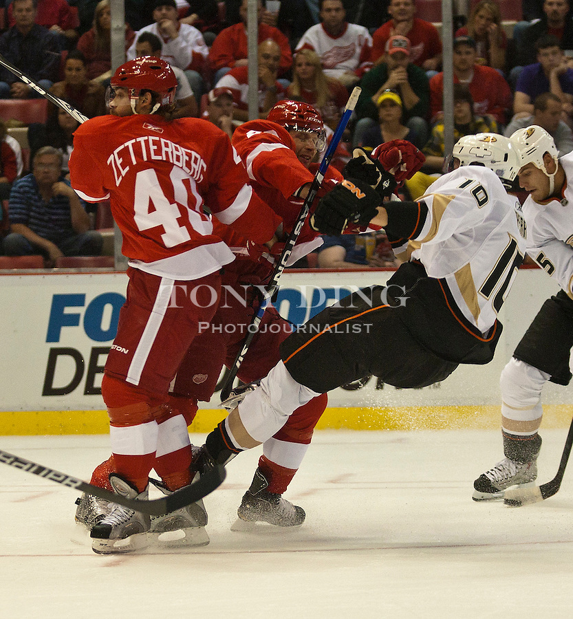 8 October 2010: Detroit Red Wings forward Henrik Zetterberg (40) gets out of the way as defenseman Brad Stuart, center, makes a hit on Anaheim Ducks forward Corey Perry (10), in the first period of the Anaheim Ducks at Detroit Red Wings NHL hockey game, at Joe Louis Arena, in Detroit, MI...***** Editorial Use Only *****