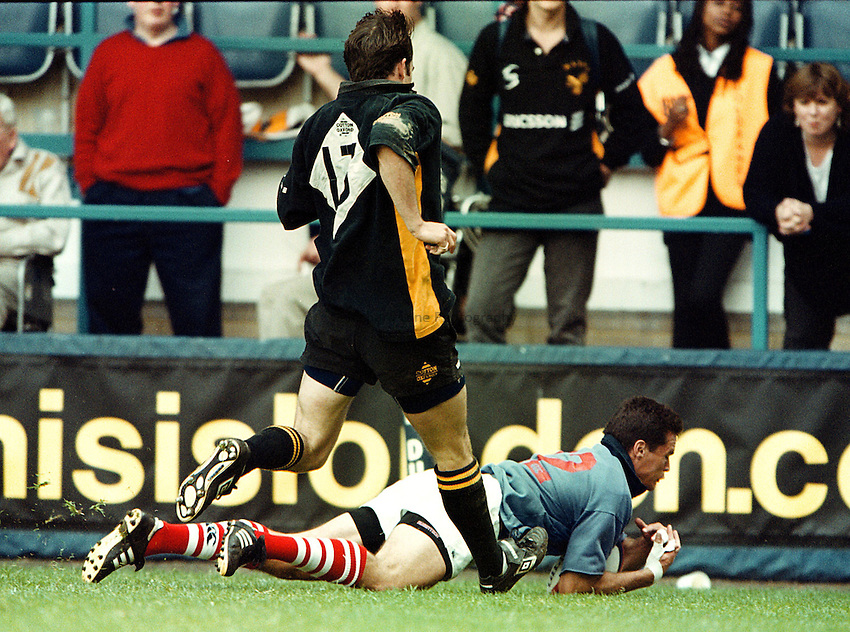 Photo: Richard Lane.Wasps v London Scottish  2.5.99.Conan Sharman goes over for London Scottish for a consolation try.