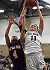 Sarah Pulis #11 of Baldwin, right, grabs one of her 15 rebounds during the Class AA varsity girls basketball Long Island Championship against Central Islip at SUNY Old Westbury on Saturday, March 11, 2017. Baldwin, who led by one point (31-30) late in the third quarter, used a 22-0 run spanning the third and fourth quarters en route to a 56-31 win.