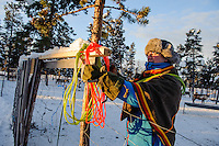 Coral hand Jakob preparing to lasso and catch some reindeer - Reindeer, sledding, and Sami culture