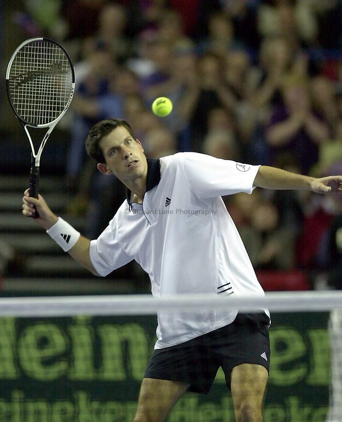 Photo:Ken Brown .6.4.2001 Davis Cup Great Britain v Portugal.Tim Henman v Tiago Vinhas De Sousa.Henman celebrates victory by hitting a ball into the crowd
