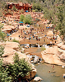 USA, Arizona, Sedona, crowd of people having fun at Oak Creek in the Summertime