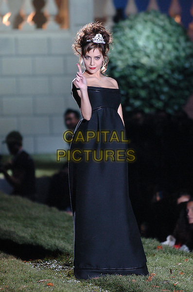 BRITTANY MURPHY.Milan Men's Fashion Show - Collection  Autumn/Winter 06/07.Photo: Omega/Garofalo/Capital Pictures.Ref: OME.full length black dress off the shoulder finger.www.capitalpictures.com.sales@capitalpictures.com.© Capital Pictures.
