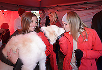 NWA Democrat-Gazette/BEN GOFF @NWABENGOFF Elizabeth Rose of Fayetteville holds her dog Cotton as friend Maddie Smart of Blytheville gives Cotton a kiss on Saturday Nov. 21, 2015 while tailgating before the Arkansas football game against Mississippi State in Fayetteville.