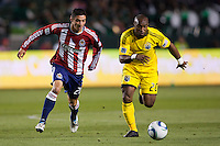 Columbus Crew forward Emilio Renteria (20) and defender Zarek Valentin (20) of Chivas USA chases down a ball. Chivas USA and Columbus Crew played to a 0-0 tie at Home Depot Center stadium in Carson, California on  April  9, 2011....