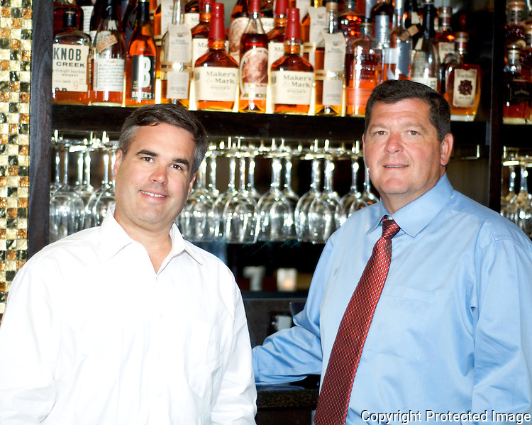 Bruce Drake (right) and Brian McCarty own Malone's in Lexington, Ky. The high-end steakhouse prominently features bourbon on its cocktail menu.