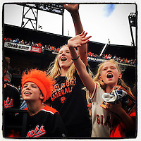 SAN FRANCISCO, CA - SEPTEMBER 28: Instagram of fans of the San Francisco Giants cheering after a game against the San Diego Padres at AT&T Park on September 28, 2014 in San Francisco, California. Photo by Brad Mangin
