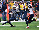 Althoff wide receiver Melvin Brock (12, left) maneuvers to evade Carterville's Justin Johnson (10) in first quarter action.The Althoff Catholic High School Crusaders defeated the Carterville Lions 42-0 in a first-round Illinois High School Association Class 4A football playoff game on Saturday October 28, 2017 in Belleville.