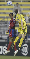 08 November 2006: CSD Municipal's Henry Medina, left, and Columbus Crew's Ryan Coiner jump for a header during the second half in Columbus, Ohio.<br />